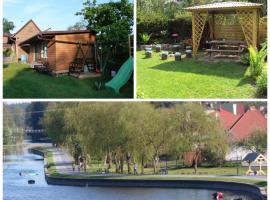 Domek + pokoje nad kanałem, villa in Augustów