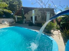 Lugar inesquecível na paradisíaca praia do sonho verde, hotel with pools in Paripueira