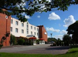 Atrium Hotel Krüger, отель в Ростоке