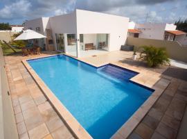 Casa com Piscina e 02 Suítes Paraiso do brasil, hotel with pools in Touros