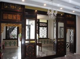 Heeren Palm Suites, hotel di Melaka