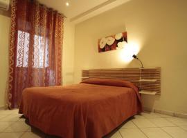 Vesta-Apartments, camera con cucina a Catania
