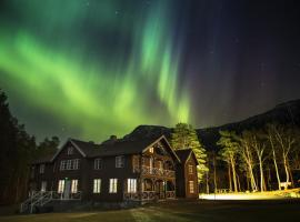 Phillipshaugen Lodge, hotell på Øksendalsøra