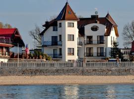 Dom Przy Plaży SPA, hotel with jacuzzis in Sarbinowo