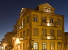 Domus 26 Guesthouse - B&B, quarto em acomodação popular em Braga