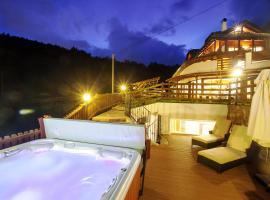 Chalet Grumer Suites&Spa, hotell i Oberbozen