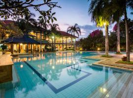 Plagoo Holiday Hotel, отель в Нуса-Дуа
