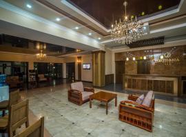 Hotel Orto Asia, отель в Оше