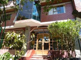 Hosteria y Spa Isla de Baños, hotel em Baños