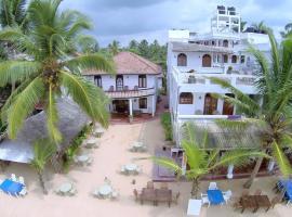Royal Beach Hotel & Restaurant, отель в Хиккадуве