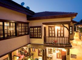Cicerone Lodge Hotel, отель в Анталье