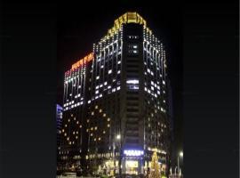 Enrichee Gloria Plaza Hotel, отель в городе Huangdao
