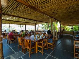 Mucumbli, hotel in Ponta Figo