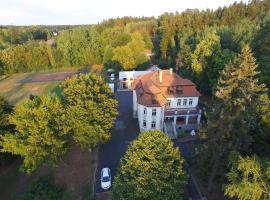 Vila Olga, hotel v Jevanech