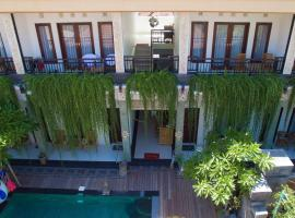 Pujihouse One, hotel with pools in Legian
