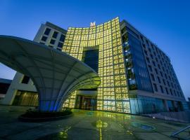 Grand Millennium Muscat, отель в Маскате