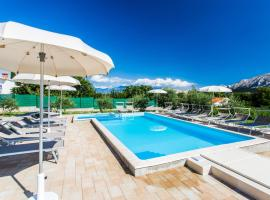 Apartments Lucija, hotel with pools in Baška