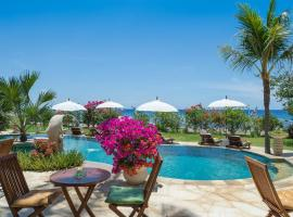 Palm Garden Amed Beach & Spa Resort Bali, holiday park in Amed