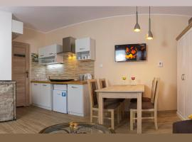 Cozy Apartment With Garden, hotel in Gdańsk
