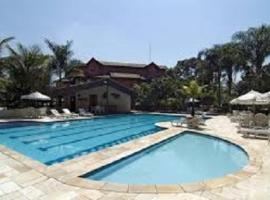 Flat Na Riviera, hotel em Riviera de São Lourenço