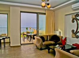 Sea View Beachfront Villa Peri, budget hotel in Gouves