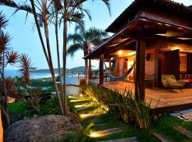 Villa Gardena Suites, homestay in Praia do Rosa