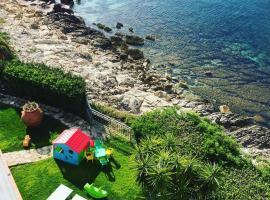 Villa Grachira, hotel in zona Spiaggia Le Bombarde, Fertilia