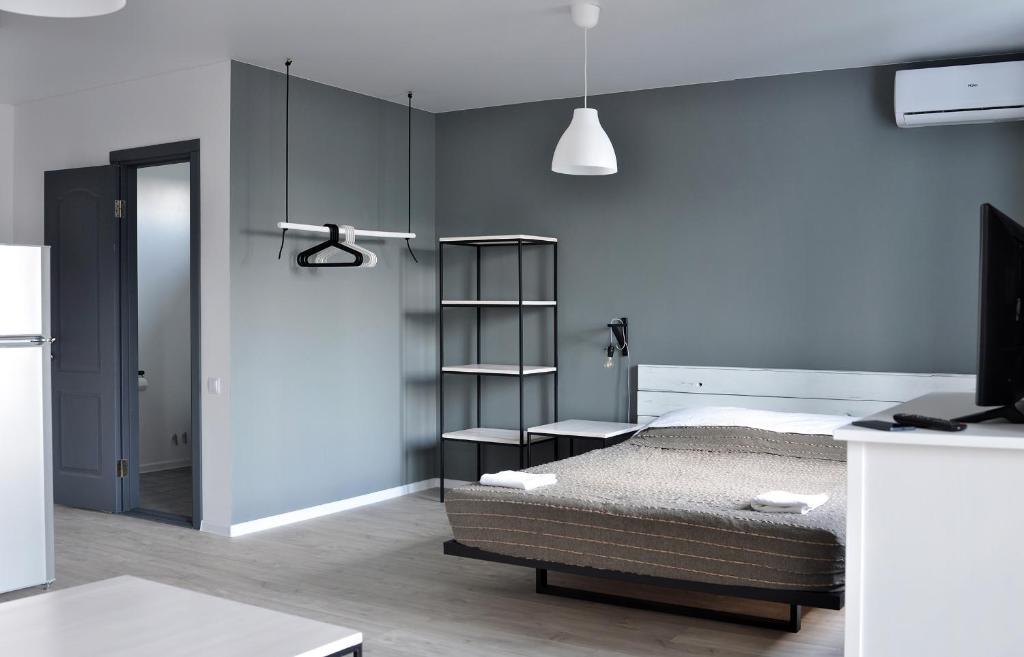 Кровать или кровати в номере Отель Wigwam