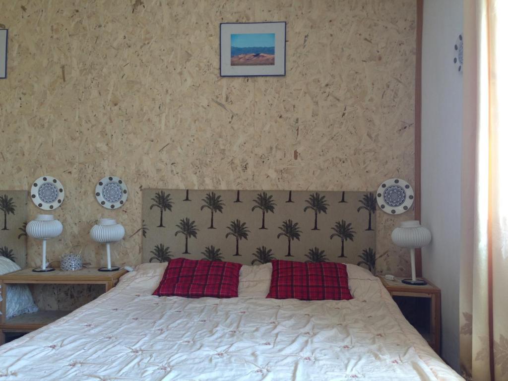 Ein Bett oder Betten in einem Zimmer der Unterkunft Gana's Guest House and Tours
