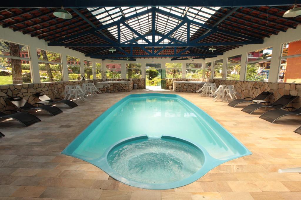 The swimming pool at or near Pousada Suarez