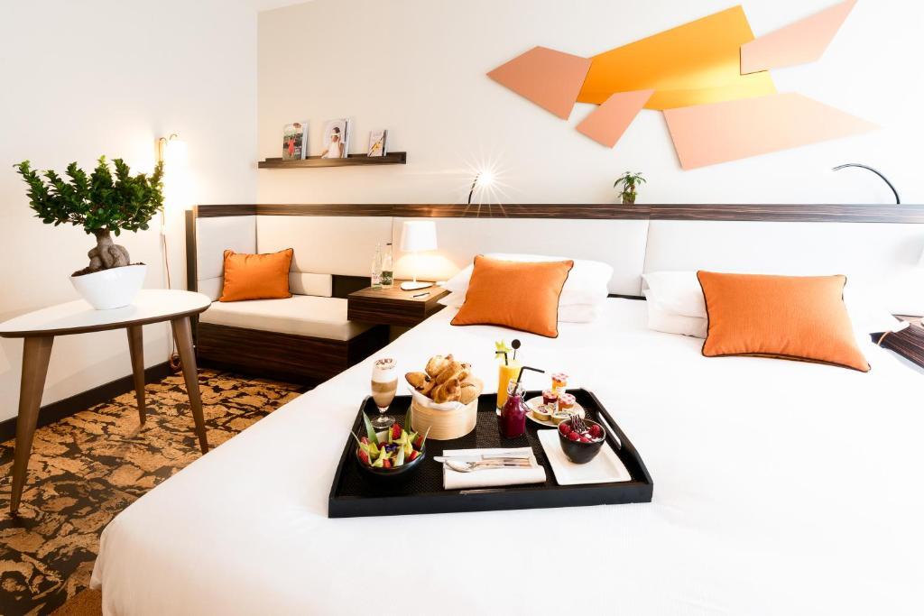 Un ou plusieurs lits dans un hébergement de l'établissement Radisson Blu Paris-Boulogne