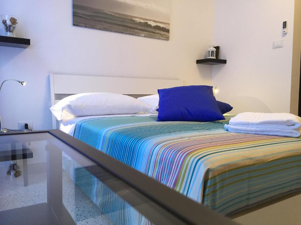 A bed or beds in a room at B&B Portarotese