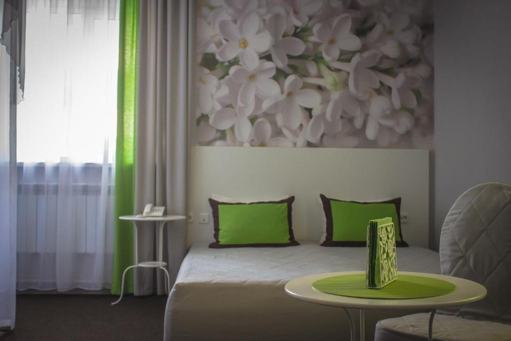Кровать или кровати в номере Aura Hotel-ZURO
