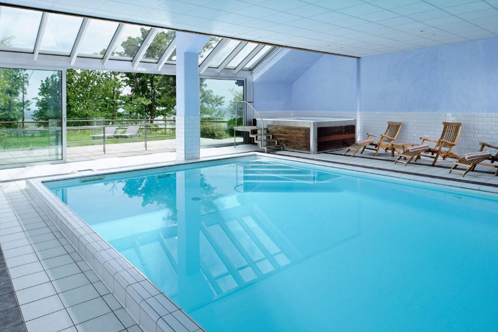 The swimming pool at or near Le Clos Saint-Vincent