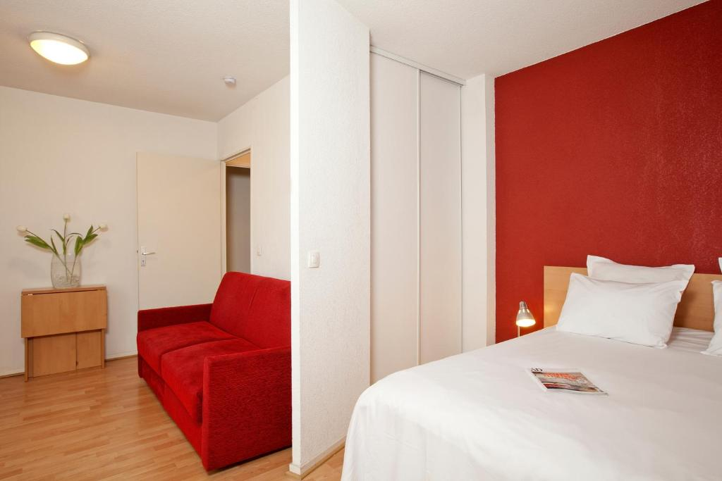Un ou plusieurs lits dans un hébergement de l'établissement Séjours & Affaires Paris-Nanterre