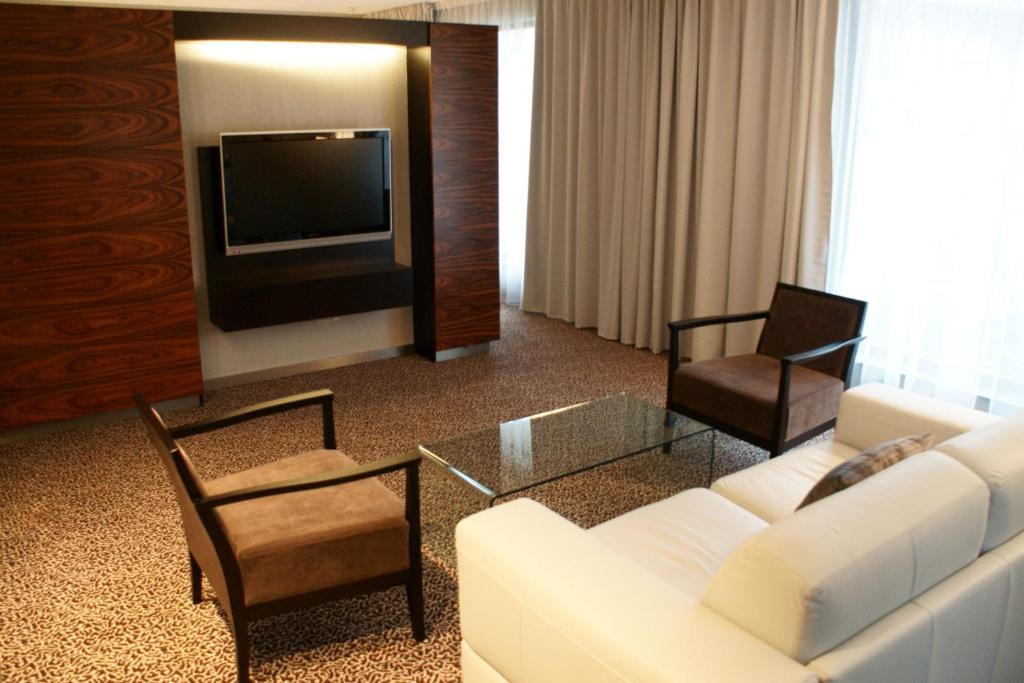 A television and/or entertainment center at Hotel Avance