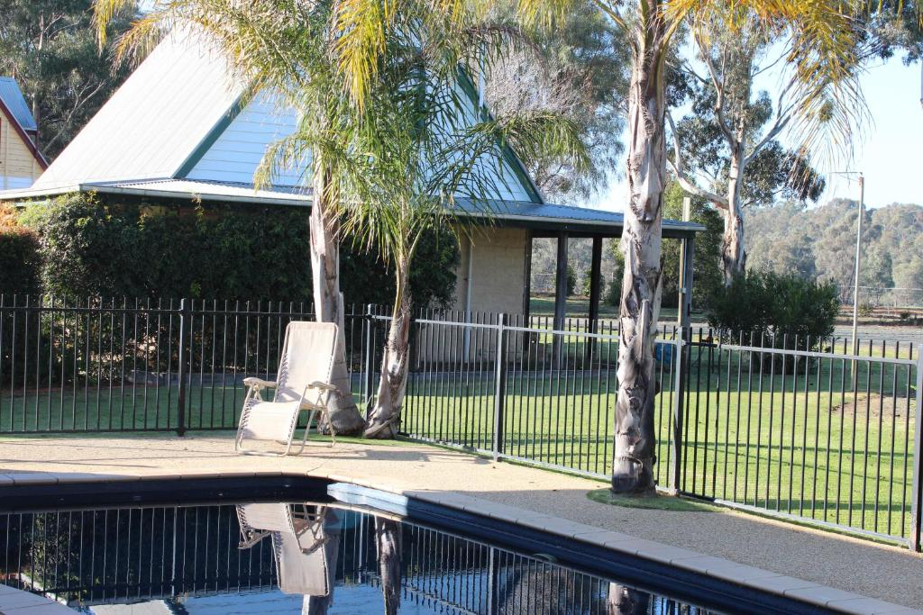 The swimming pool at or near Elinike Guest Cottages