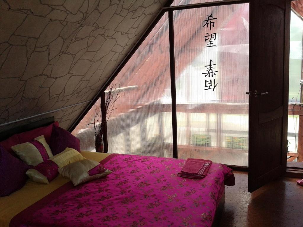 Кровать или кровати в номере Chastnoe Vladenie Kamchatka