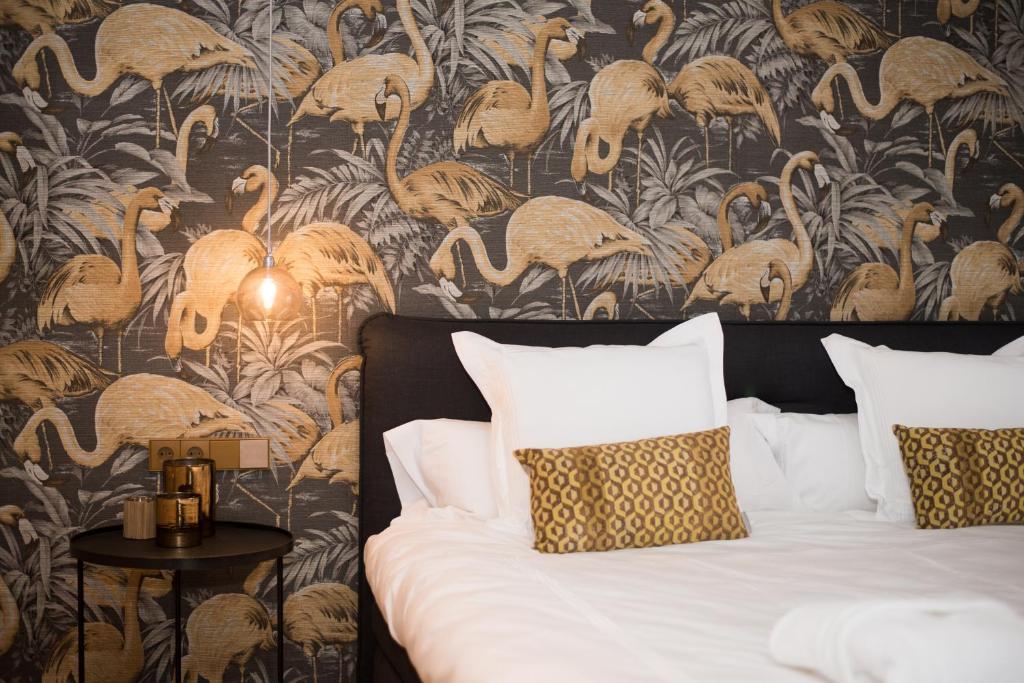 Een bed of bedden in een kamer bij Hotel 't Keershuys