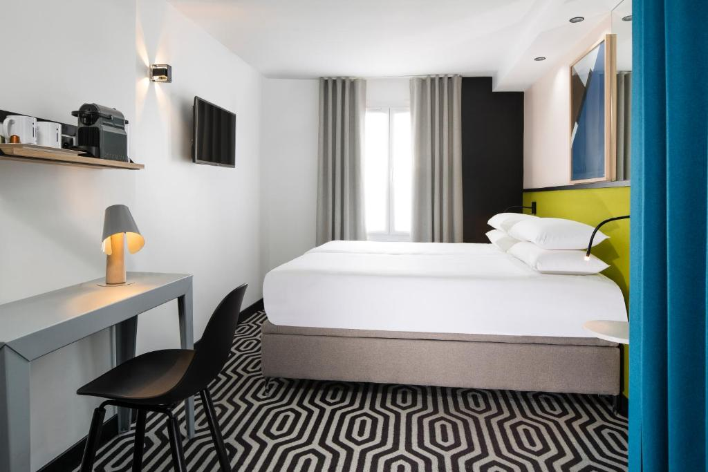 A bed or beds in a room at Hotel Pilime