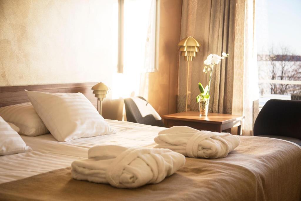Säng eller sängar i ett rum på Hotel Arkipelag