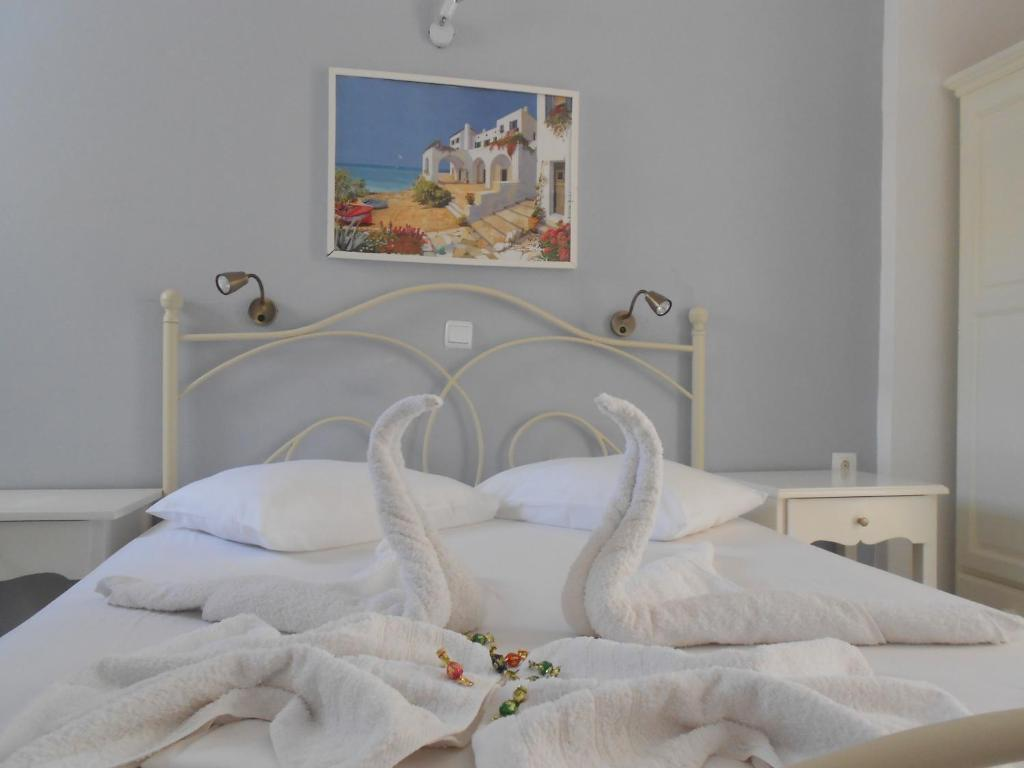 A bed or beds in a room at Nicolas Studios