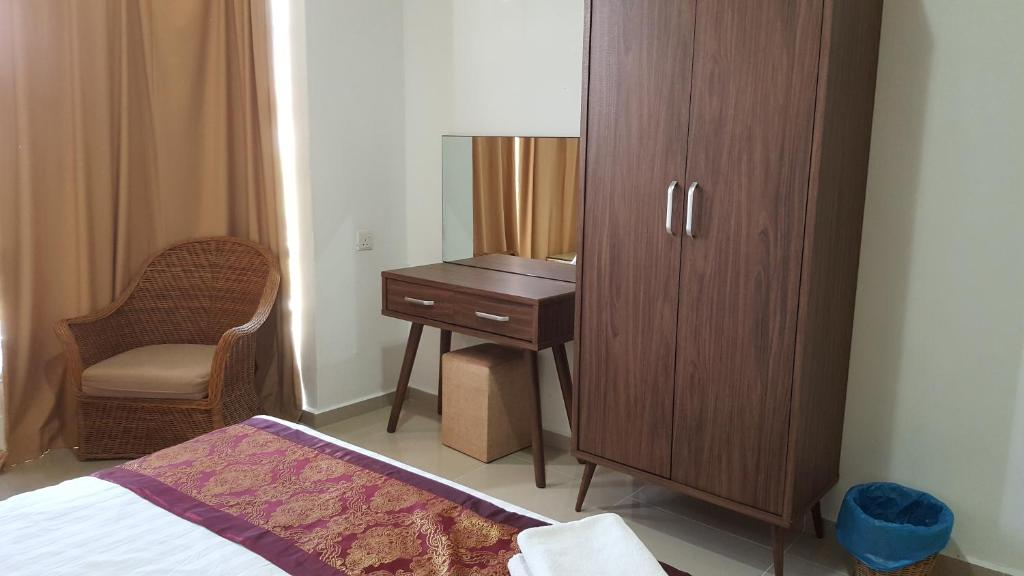 A bed or beds in a room at Mahkota Hotel Melaka Private 2bedroom apartment