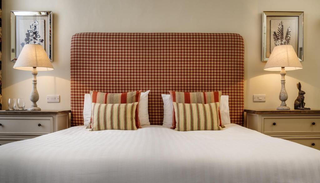 A bed or beds in a room at The George