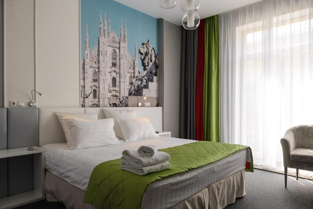 A bed or beds in a room at Ahotels Design Style on Sovetskaya