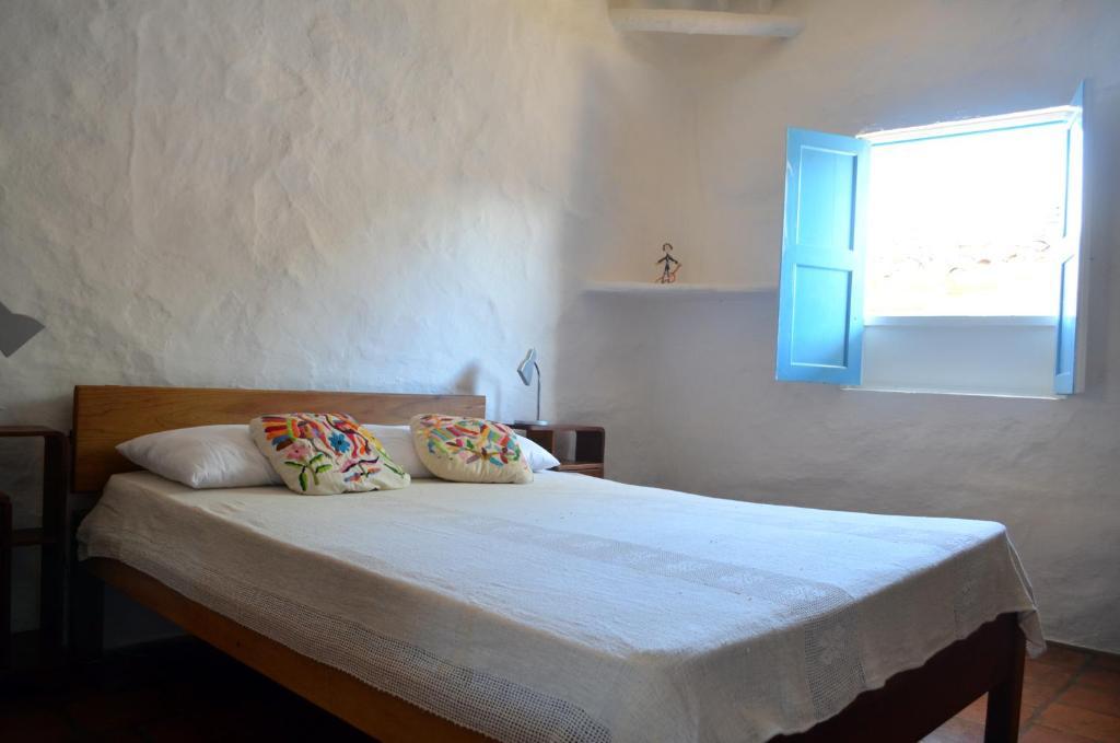 Кровать или кровати в номере Albahaca Hospedaje Tienda