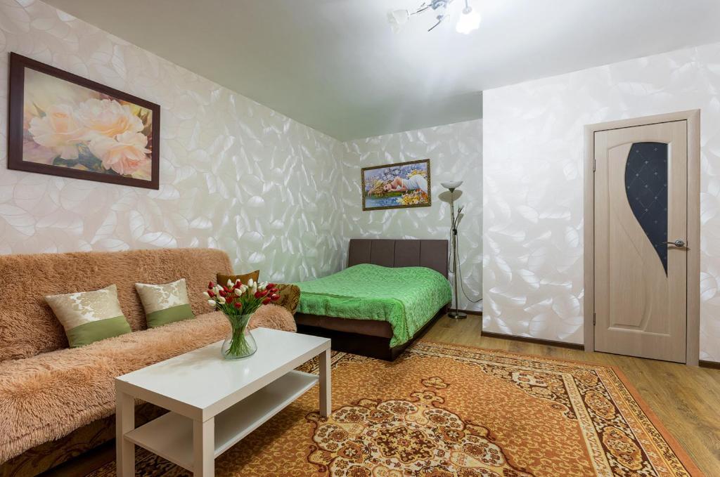 Кровать или кровати в номере Apartment on Perevertkina 1/7