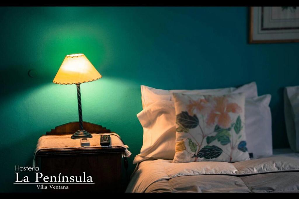 A bed or beds in a room at Hostería La Península