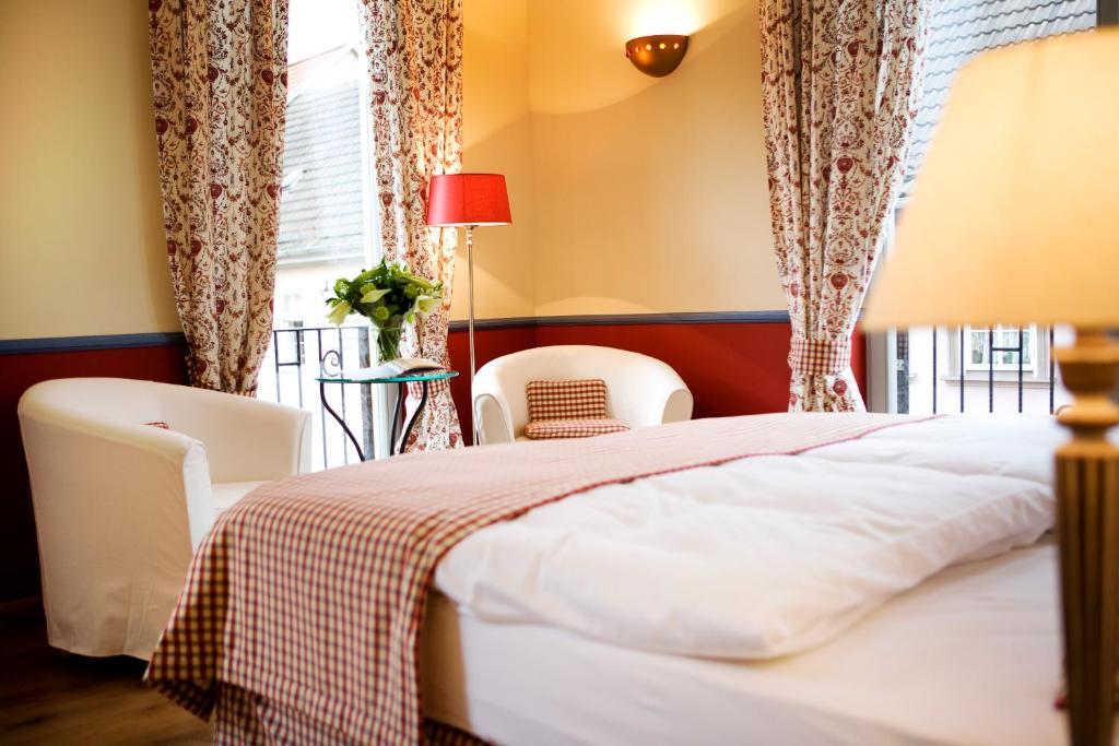 Ein Bett oder Betten in einem Zimmer der Unterkunft Pension La Casa dei Colori