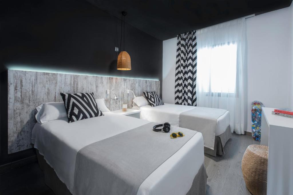 Letto o letti in una camera di Aparthotel Playasol Mogambo